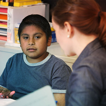 Teacher talking with a student