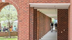 Brick courtyard with students at picnic table