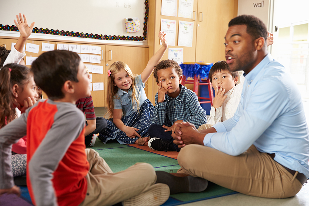 Kids engagaging with their teacher in the classroom