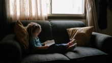 A child reading in a living room