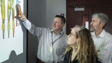Professor Joe Hart points to a projection of 3D renderings of leg muscles