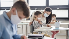 Students in classroom wearing masks for health protection