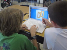 students work on designs on the computer