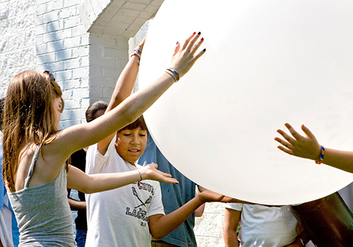Summer Enrichment Program students holding weather balloon