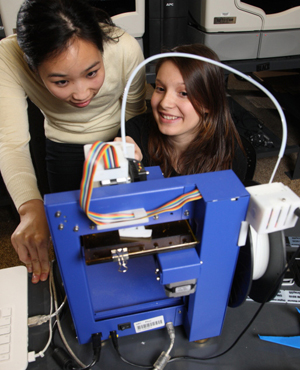 Students watching their 3D design being printed